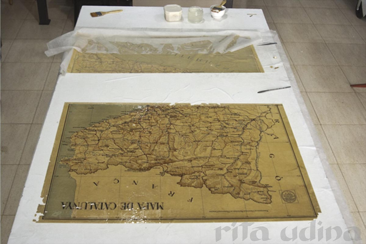 4. The two separate parts of the map, clean and without varnish.