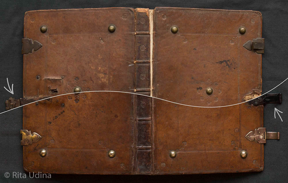leather binding with brass bosses and clasps, before and after conservation